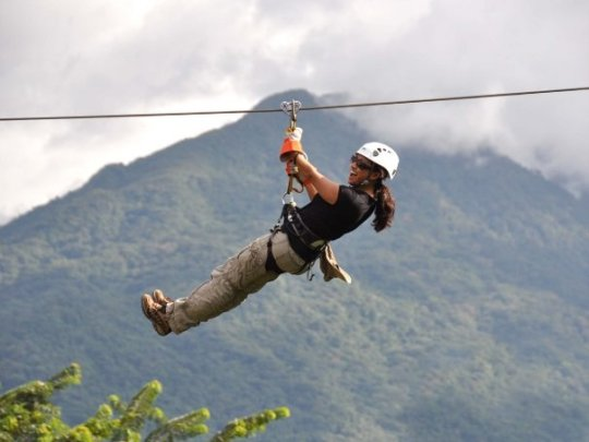 Ziplining above the jungle canopy.