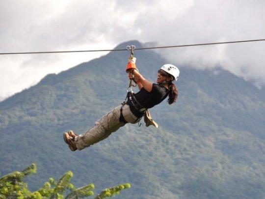 Ziplining above the jungle canopy.