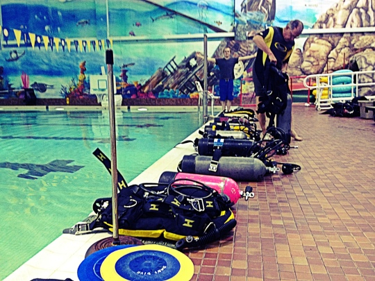 Getting tanks and gear set up early for a large Discover Scuba Diving class